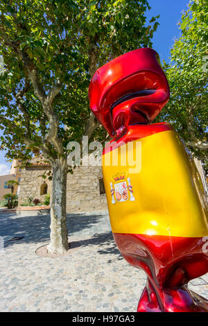A sculpture, a piece of public art, by Laurence Jenkell, depicting a bonbon, or candy painted with Spanish flag - Stock Image