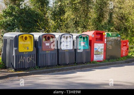 Recycling bins for drink cans, brown glass, clear glass, green glass, clothes and papoer at Hinksey, Oxford - Stock Image