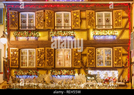 Christmas street at night in Colmar, Alsace, France - Stock Image