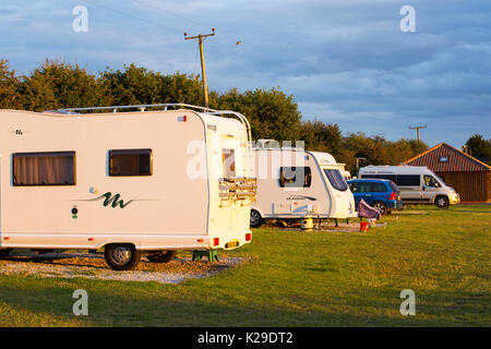 A campsite at dusk in Cley, Norfolk, UK. - Stock Image