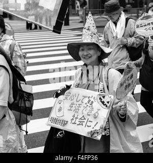 Japanese anti-war and constitutional change protesters with a Halloween theme in Ginza, Tokyo - Stock Image