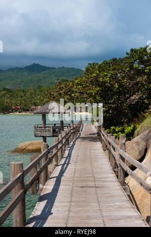 Boardwalk near lighthouse of Phangan island, Thailand - Stock Image