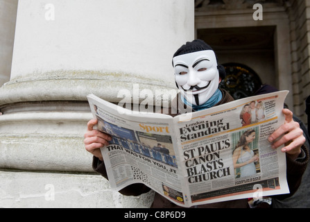 Occupy the Stock Exchange protest outside Royal Exchange, London. Some protestors have adopted the V for Vendetta - Stock Image