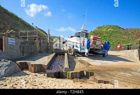 Local fishing boat and tractor off the beach on the access gangway on the North Norfolk coast at East Runton, Norfolk, England, UK, Europe. - Stock Image
