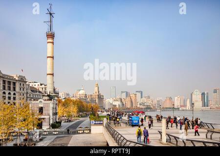 29 November 2018: Shanghai, China - Visitors walking on The Bund, beside the Huangpu River, Shanghai. - Stock Image