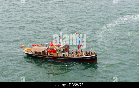 Passengers in a steam propelled boat enjoying Australia Day on Sydney Harbour 2013 - Stock Image
