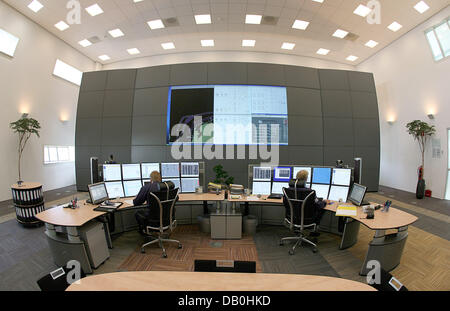 Employees of energy company Wintershall pictured working in the 'Remote Controlled Operations' (RCO) control - Stock Image