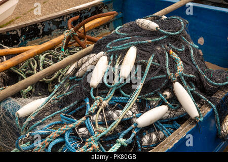 UK, England, Yorkshire, Filey, Coble Landing, fishermen's nets and floats in fishing boat - Stock Image