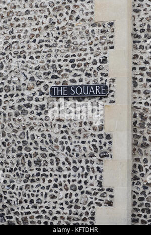 Sign saying 'The Square' in a flint and sandstone wall. Winchester, Hampshire, England, UK., - Stock Image
