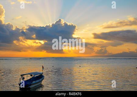 A beautiful sunrise over the Sanur Beach in Bali Indonesia. - Stock Image