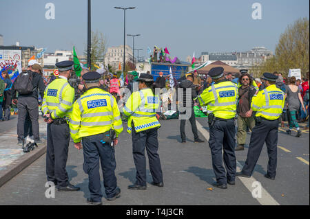 London, UK. 17th April, 2017. Extinction Rebellion Climate Change protesters continue a blockade of Waterloo Bridge to vehicle traffic but with a heavier police presence. Credit: Malcolm Park/Alamy Live News. - Stock Image