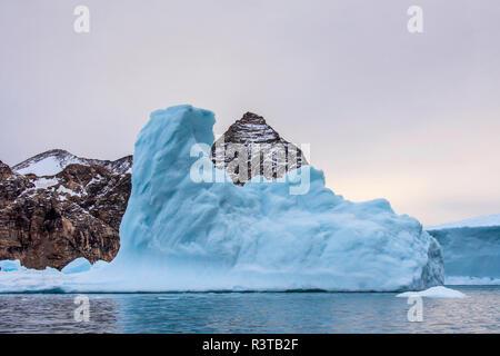 Greenland. East Greenland. Liverpool Land. Warming Island. Dense blue iceberg. - Stock Image