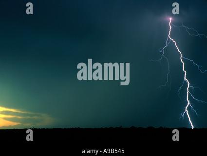 Australia South Australia Coober Pedy Lightning over mining equipment - Stock Image