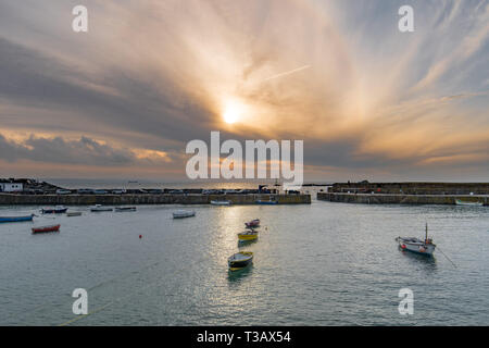 Mousehole, Cornwall, UK. 8th April 2019. UK Weather. The sun just starting to break through the low clouds this morning at Mousehole, for the first week of the Easter holidays. Credit: Simon Maycock/Alamy Live News - Stock Image