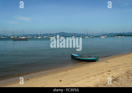 fishing boat and yachts in the sea near the coast - Stock Image