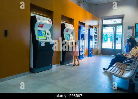 Aix-en-Provence, Child at Train Ticket Distributor Machine in Train Station - Stock Image