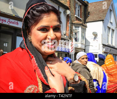 Gravesend, Kent, UK, 13th April 2019. A woman dressed in beautiful saris. Thousands of spectators and religious visitors line the streets of Gravesend in Kent to watch and participate in the annual Vaisakhi procession. Vaisakhi is celebrated by the Sikh community all over the world. - Stock Image