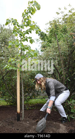 Prague, Czech Republic. 17th May, 2019. Czech snowboarder and alpine skier Ester Ledecka plants a tree in Prague Botanical Garden within the project Roots of personalities, in Prague, Czech Republic, on May 17, 2019. Credit: Michal Kamaryt/CTK Photo/Alamy Live News - Stock Image