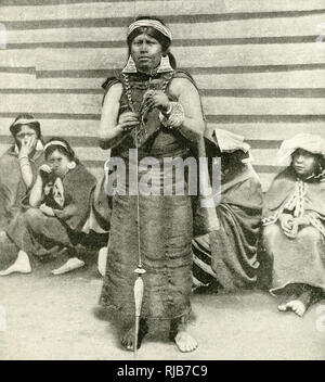 Araucanian women of southern Chile, South America. Araucania (Araucana) is an indigenous area of Chile inhabited by the Moluche (Mapuche) people. The woman standing at the centre is wearing large silver earrings. - Stock Image