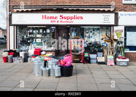 English village life - a hardware store with displays on the street in front. - Stock Image