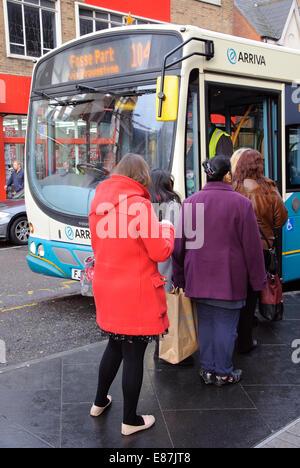 queue of people boarding Arriva single decker bus, Leicester, England, UK - Stock Image