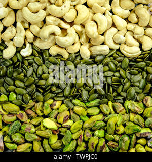 Close Up Pistachio Nuts, Pumpkin Seeds and Cashew Nuts In a Patternpile, heap, stack, - Stock Image