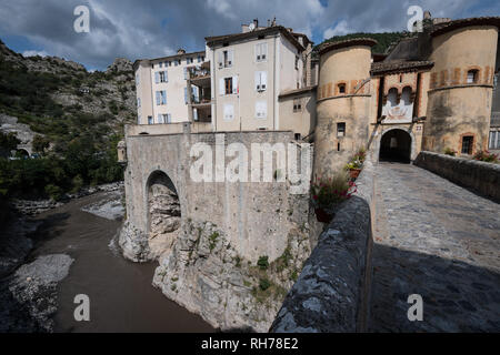 The bridge entrance to the medieval town of Entreveux, France - Stock Image