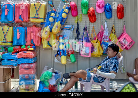 Thailand vendor selling plastic water guns for the Thai Songkran water festival - Stock Image