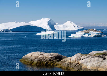 Large icebergs drifting into sea in Disko Bay ocean from Ilulissat Icefjord and Sermeq Kujalleq Glacier. Sermermiut, - Stock Image