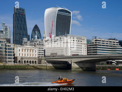 London City skyline with The Walkie Talkie, The Gherkin and The Cheese Grater to the left. type E lifeboat Rib Hulrey - Stock Image