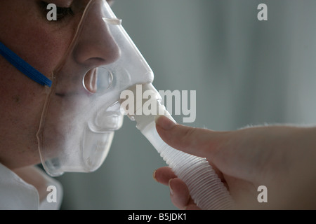 A student nurse giving gas and air on the practice ward at Caledonian University were she is currently studying - Stock Image