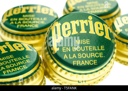 Perrier Bottle Tops, Perrier is a French brand of natural mineral water from its source in Vergeze. - Stock Image