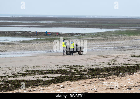 France, 2018,  Security staff use a drone to search a beach. - Stock Image