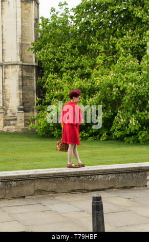 Oriental lady posing for photo in front of Kings college Cambridge 2019 - Stock Image