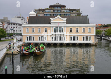 Aveiro, Portugal - April 29, 2019: Traditional boat, Moliceiro, built to transport tourists at a canal basin in Aveiro, Portugal - Stock Image