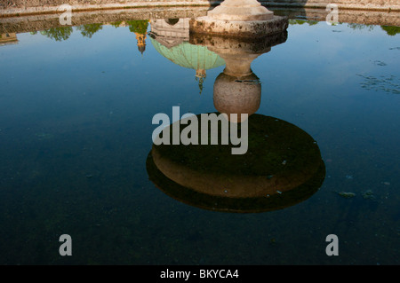 Hofgarten fountain water reflections of Diana's temple and Theatinerkirche church in Munich. - Stock Image