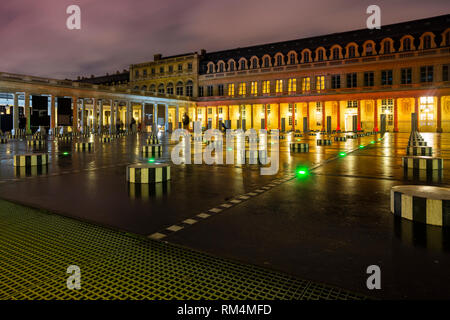 PARIS, FRANCE - NOVEMBER 10, 2018 - The columns by the conceptual artist Daniel Buren in the courtyard of honor of the Royal Palace in Paris, France - Stock Image