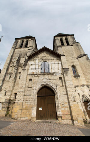 Chinon, France. Picturesque view of former Colligate Church of Saint Mexme (L'ancienne Eglise St Mexme) at Place Saint-Mexme. The church frontage cont - Stock Image