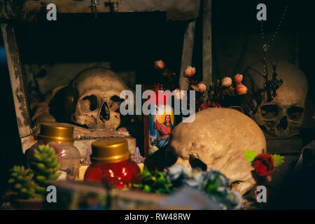 NAPLES, ITALY - JANUARY 24, 2019 - The Fontanelle cemetery is a charnel house, an ossuary, located in a cave in the tuff hillside in Materdei, Naples - Stock Image