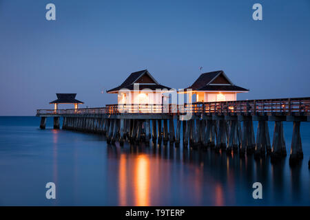Early morning twilight over the Naples Pier, Naples, Florida, USA - Stock Image