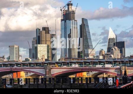 LONDON - NOVEMBER 15 : Skyscrapers under construction over Blackfriars Bridge in London, England on sunny day on 15 November 2018. - Stock Image