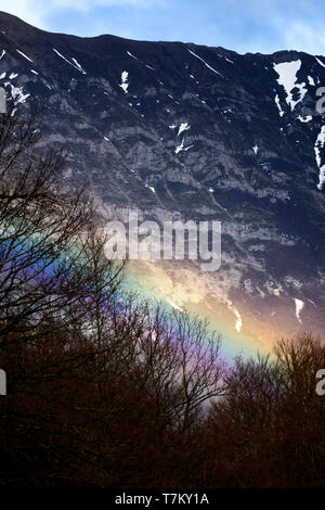 Rainbow with mountain in the background - Stock Image