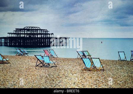 deck chairs on Brighton beach - Stock Image