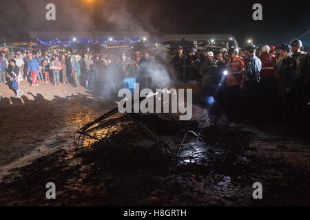 Taunggyi, Myanmar. 12 November 2016.   Debris from the basket of fireworks being inspected by emergency services. - Stock Image