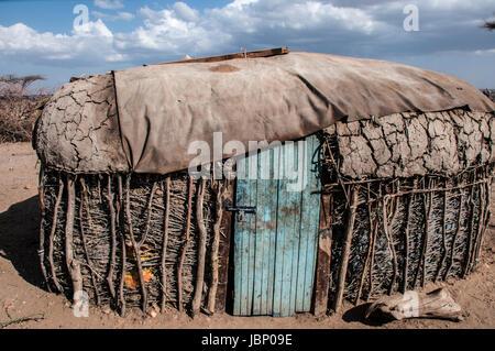 A typical hut or manyatta built with cow dung and clay by the Samburu Maasai in a Samburu village in Northern Kenya, - Stock Image