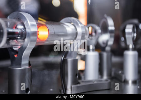 Michelson optical interferometer with the laser beam reflecting off the gas molecules in the device's chamber. - Stock Image