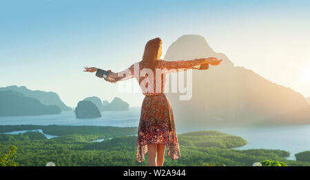 Beautiful brunette woman looking at the fabulous tropical landscape - Stock Image