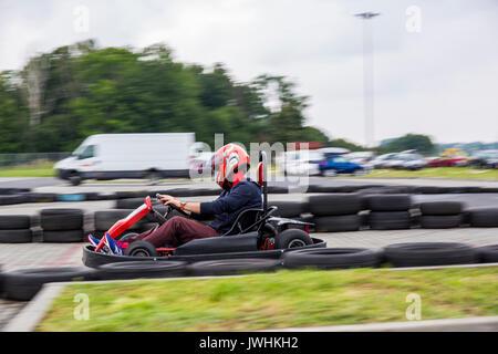 Bielsko-Biala, Poland. 12th Aug, 2017. International automotive trade fairs - MotoShow Bielsko-Biala. Man racing in a go-cart. Credit: Lukasz Obermann/Alamy Live News - Stock Image
