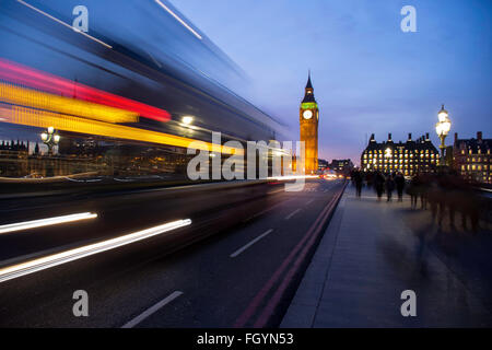 London Bus passing by on Westminster Bridge - Stock Image
