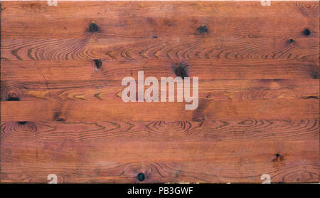 old wooden table with marks and scratches - Stock Image